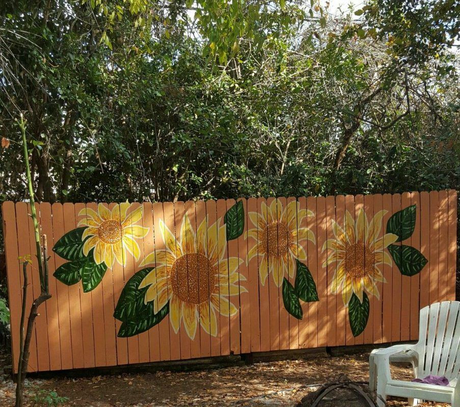 sunflower murals on wooden fences