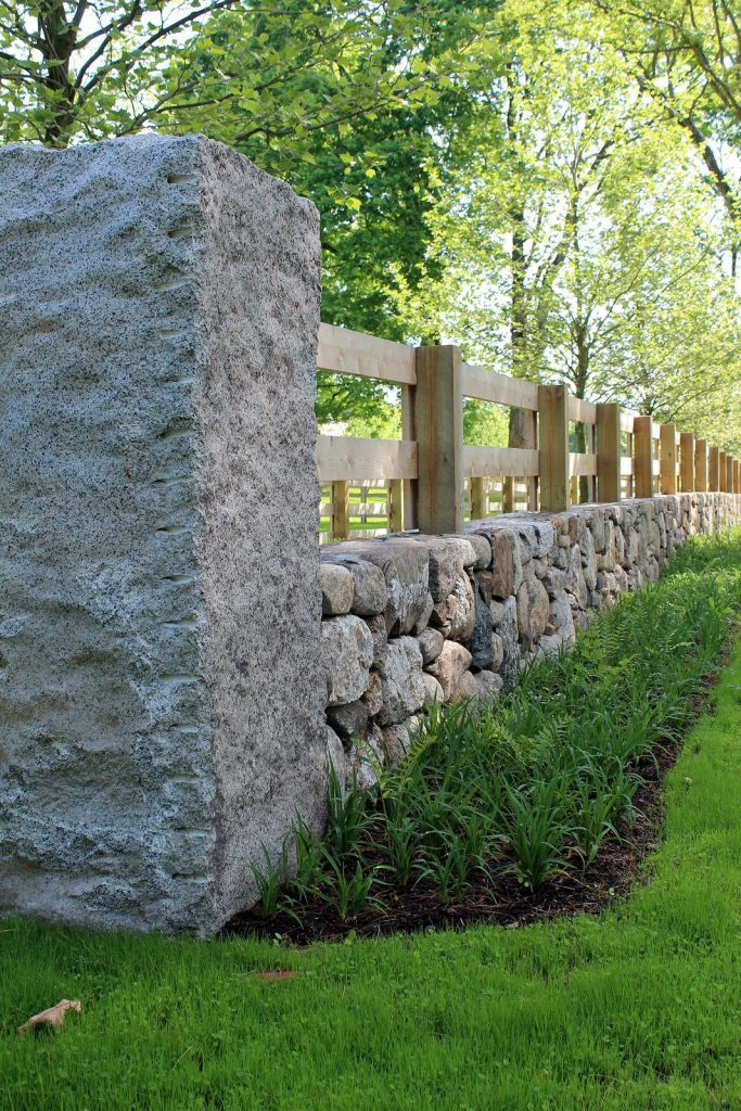simple stone and wood horse fence