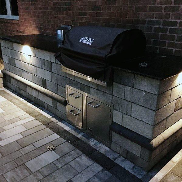 brick wall around grill